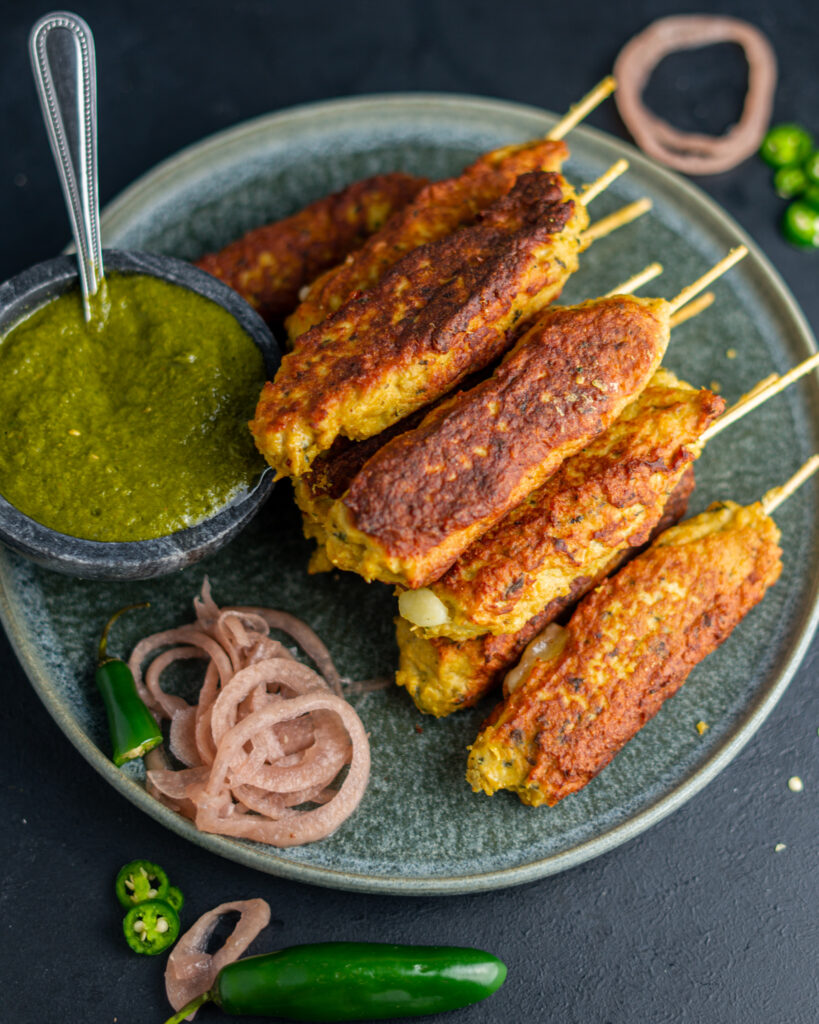Chicken Seekh Kebabs cilantro mint chutney and pickled onions