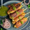 Chicken Seekh Kebabs with Garnish and Cilantro Chutney