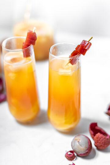 Two Guava Sangrias in Fluted Glasses with Lychees and Guava Paste Garnish