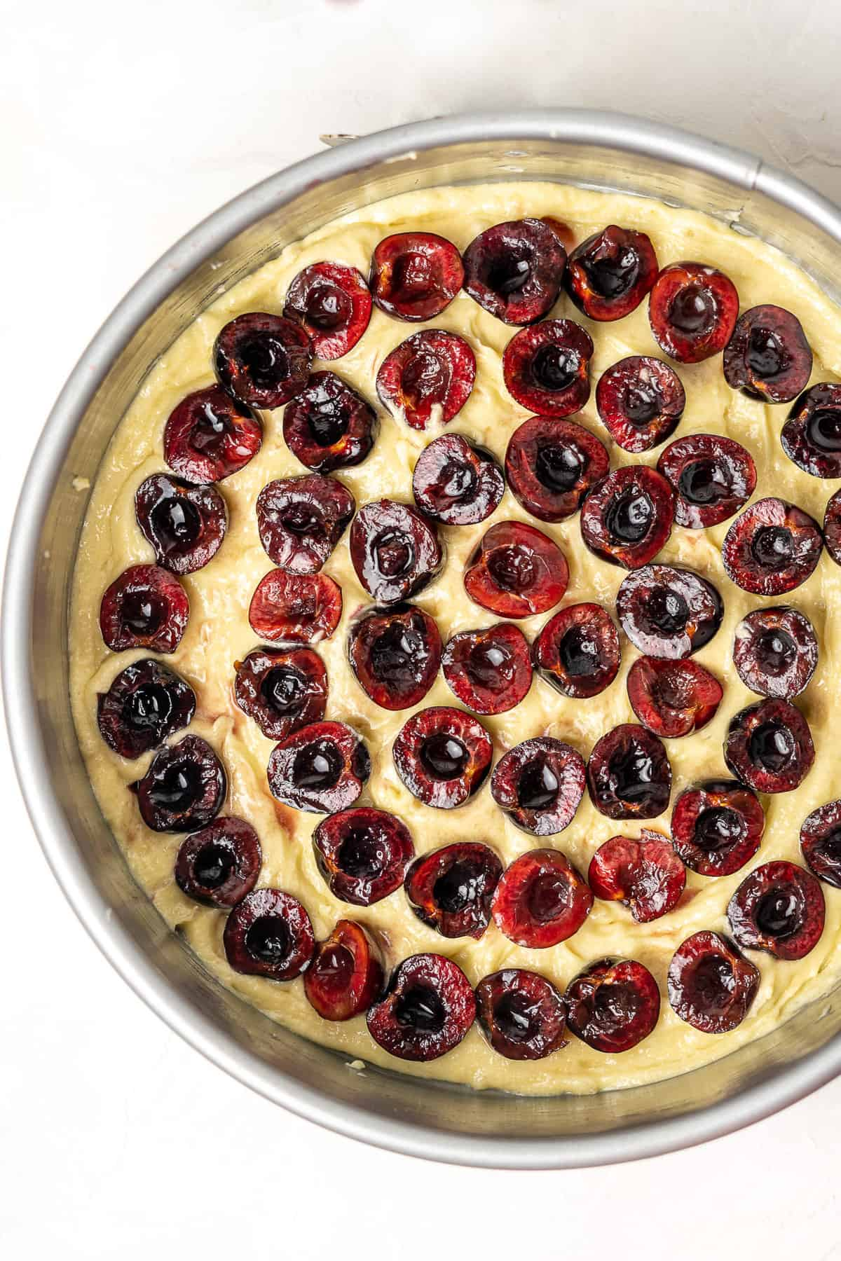 Unbaked cherry almond cake with layer of cherries
