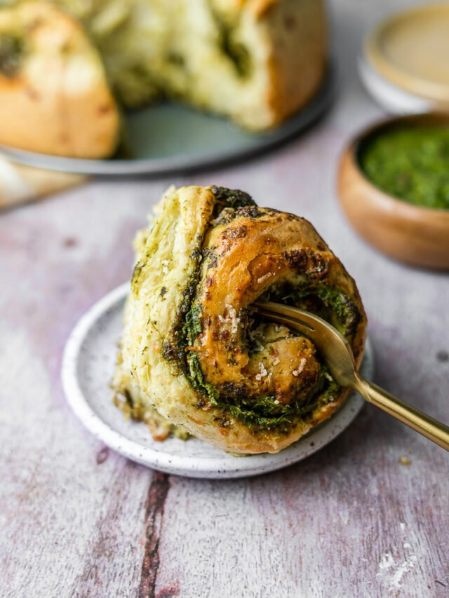 One Chutney Cheese Brioche Roll cut into with golden fork