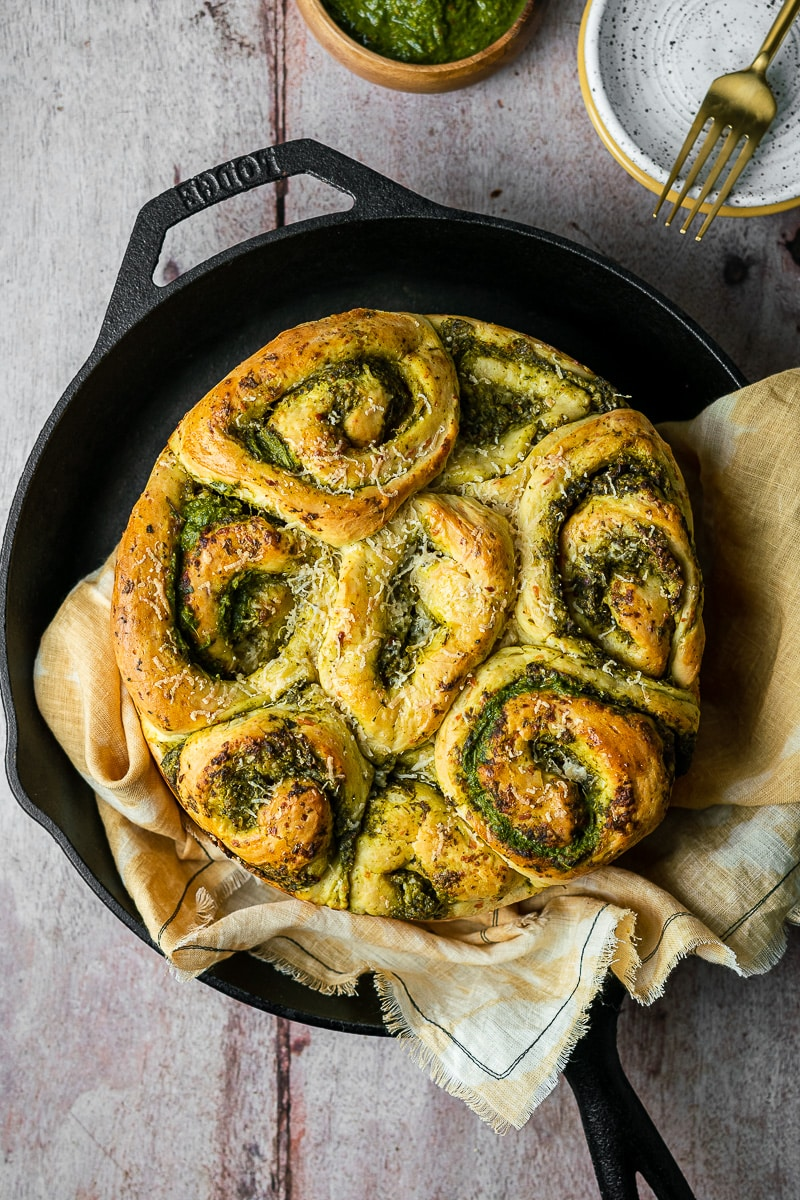 Chutney Cheese Brioche Rolls in Lodge Cast Iron Pan on yellow linen