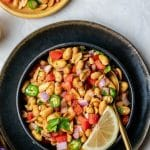Peanut Chaat in Black bowl with serrano peppers pinterest image