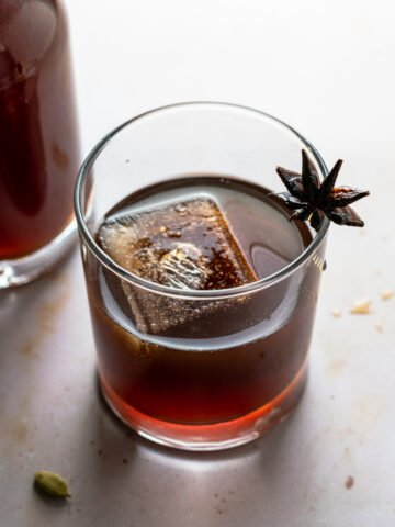 Chai Liqueur in glass with star anise garnish