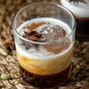 two old fashioned glasses of Chai white russian with heavy cream at the top
