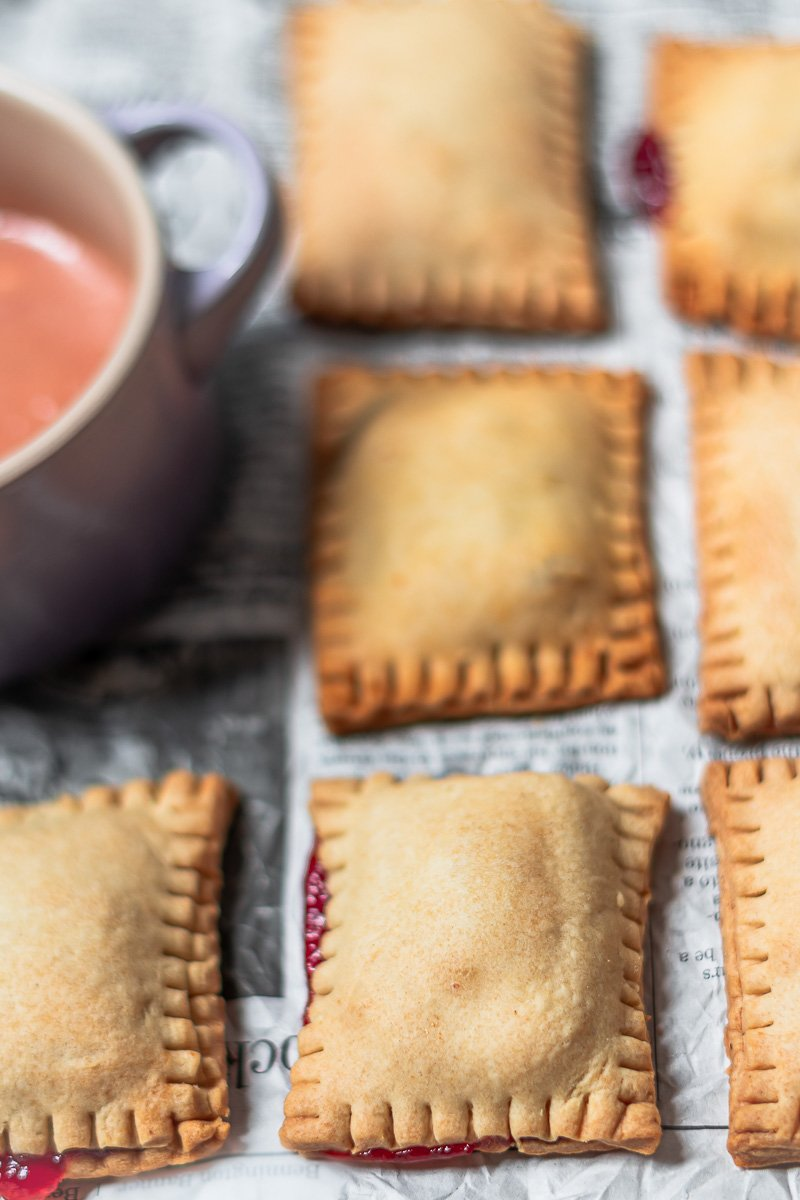 golden brown baked guava pop tarts on a piece of newspaper
