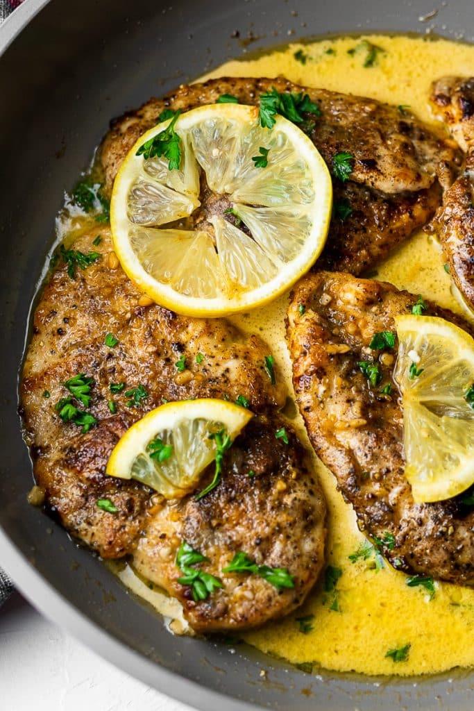 Creamy Garam Masala Lemon Butter Chicken in Pan close up on one piece of chicken