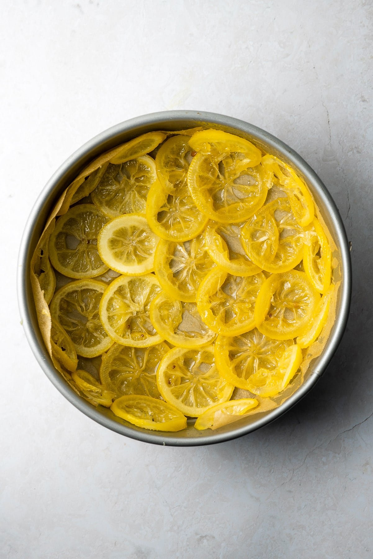 candied lemon slices layered in a springform pan