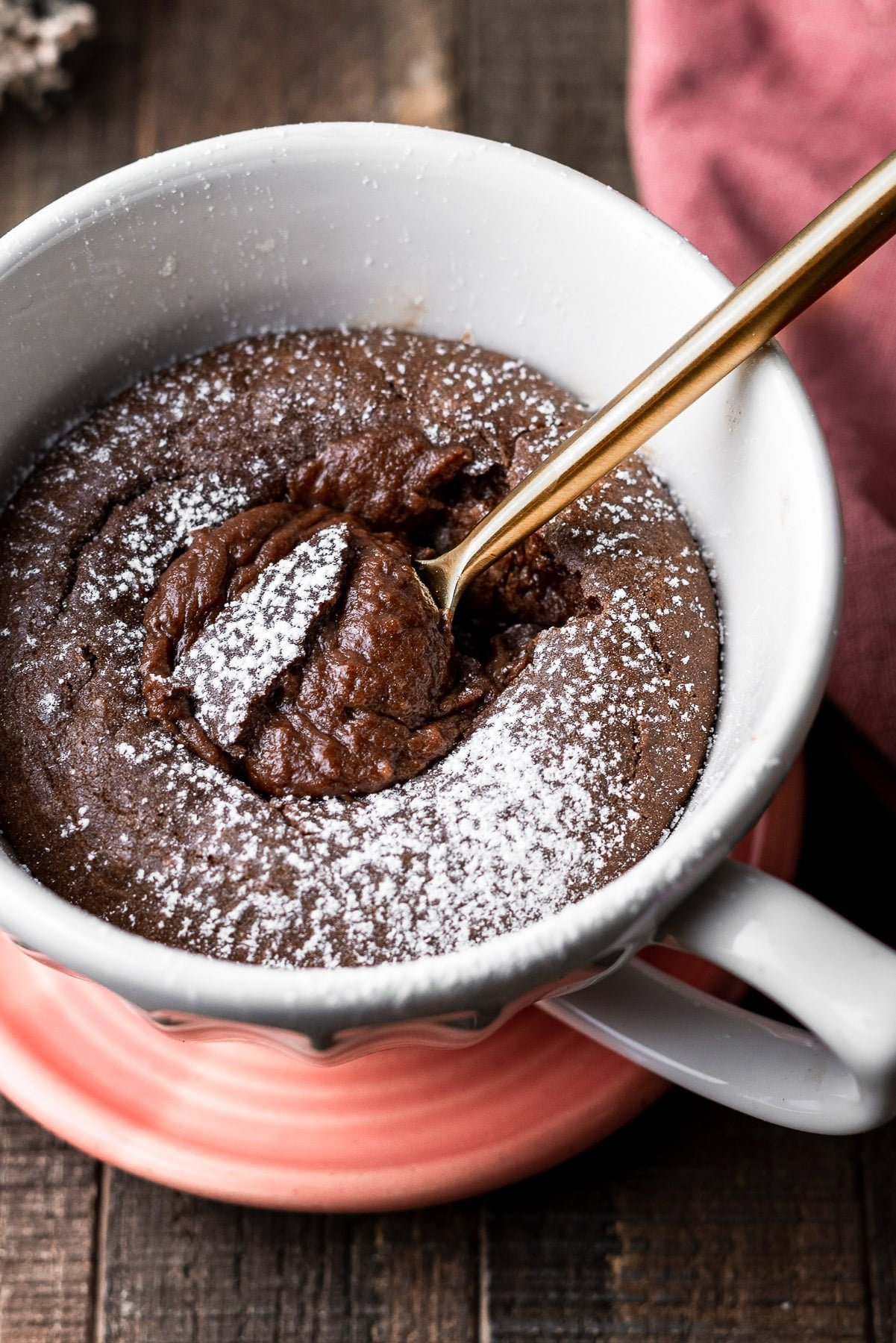 Nutella Mug Cake with a spoon in the Molten Center
