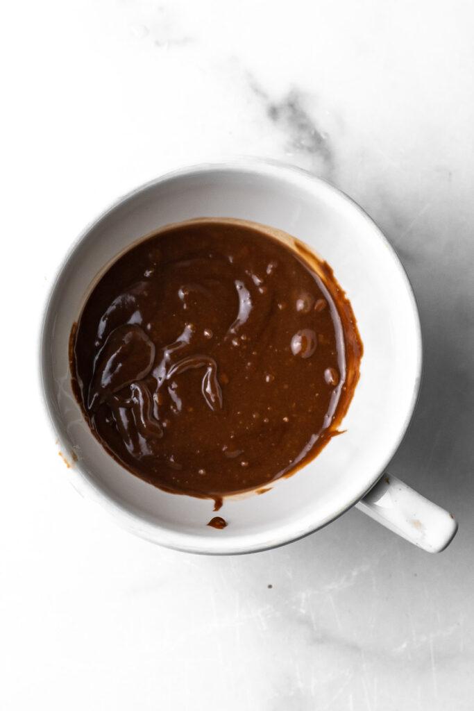 nutella lava mug cake batter in a mug