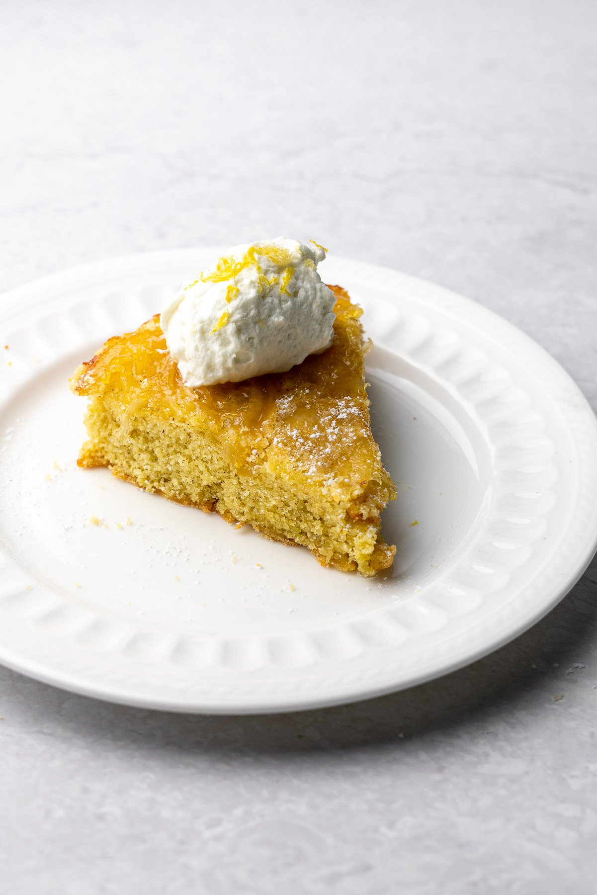 Single Slice Lemon Cardamom Olive Oil Cake on a plate