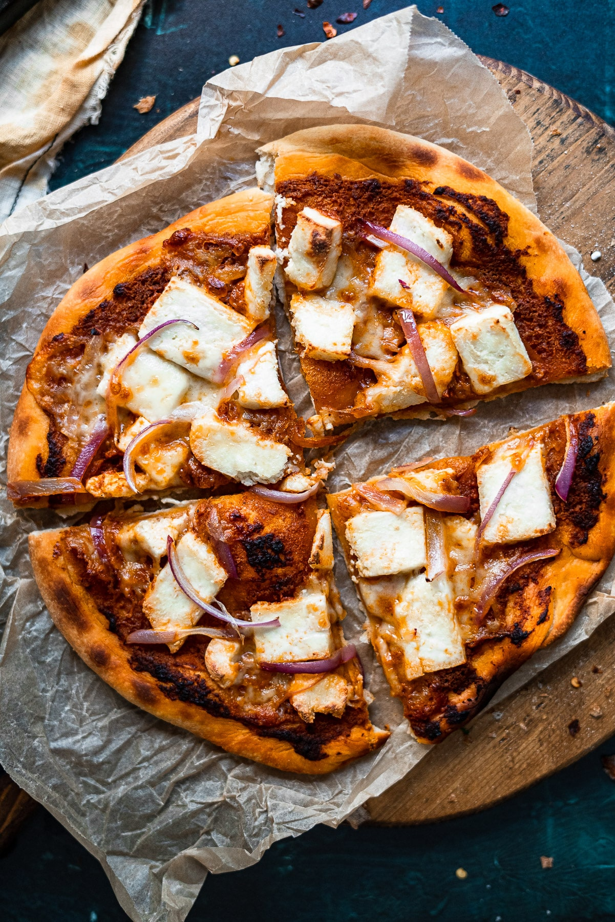 paneer makhani pizza on a wooden board