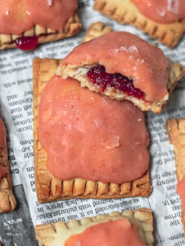 Guava Cream Cheese Poptarts with one broken in half to reveal the guava paste