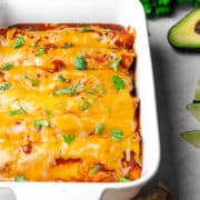 freshly baked enchiladas in a baker with melty cheese