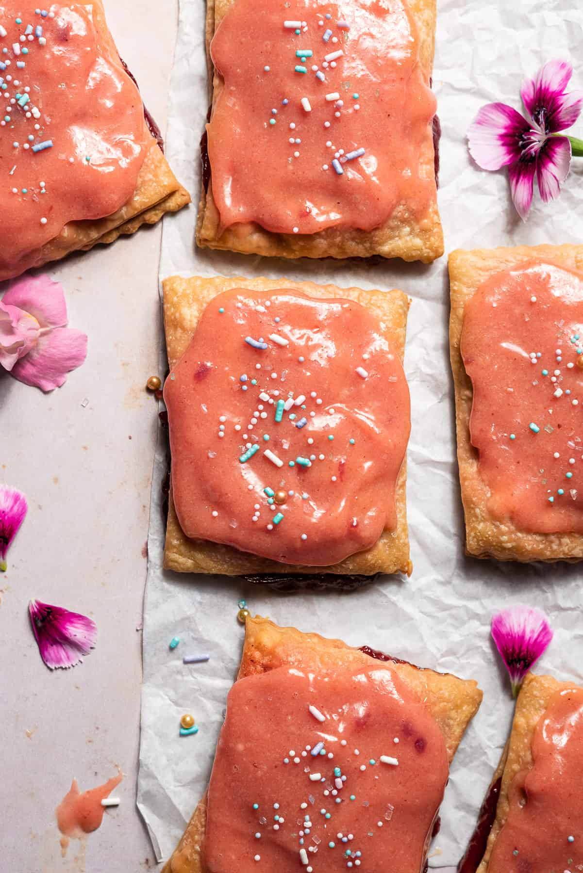 freshly glazed guava poptarts with sprinkles and edible flowers