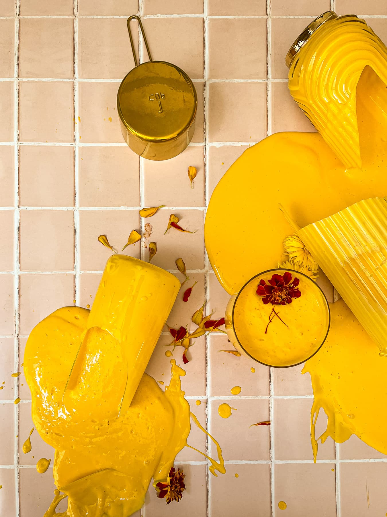 Mango Lassi cups and pitchers cracked and spilled everywhere