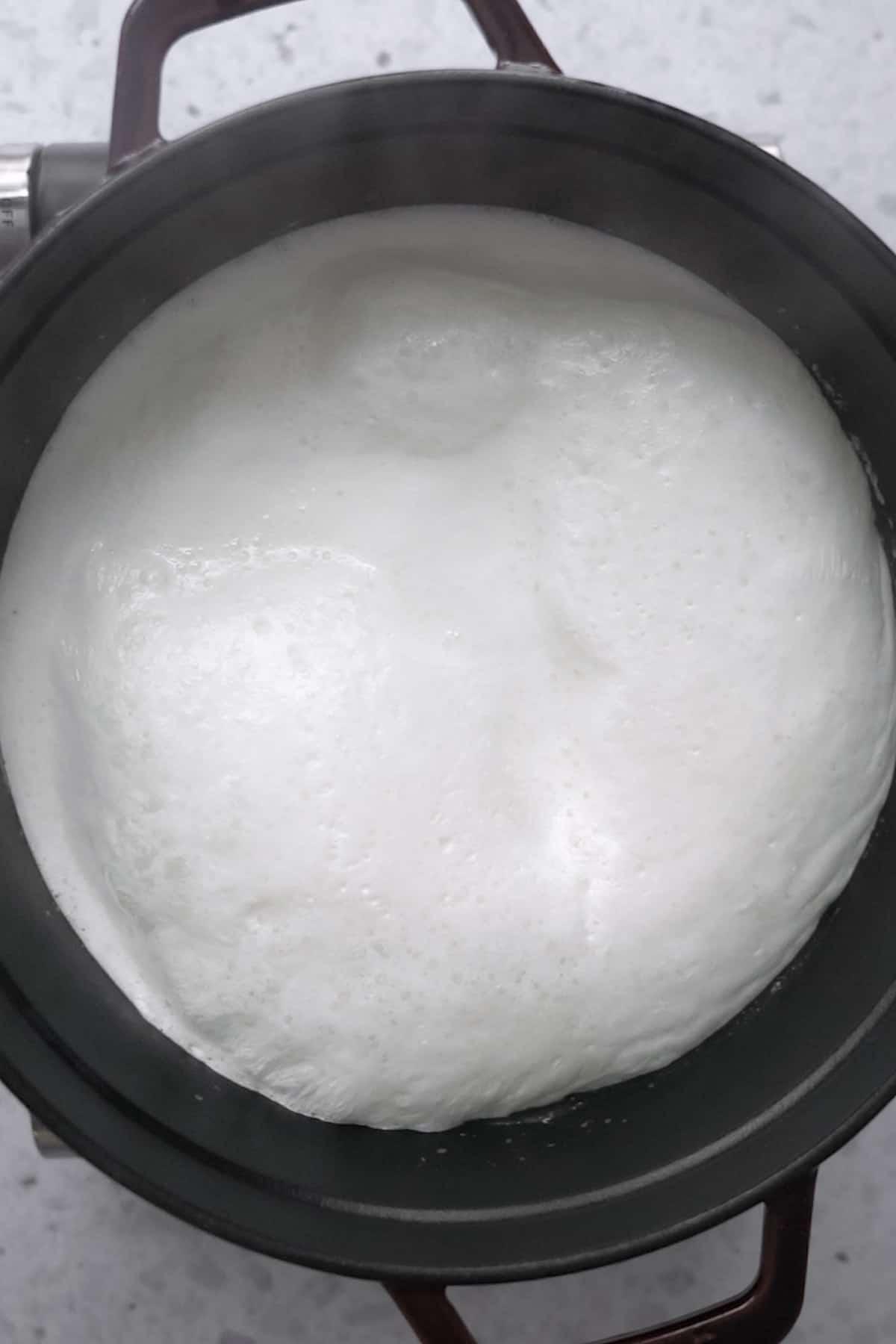 boiling milk until frothy in a heavy bottom pot