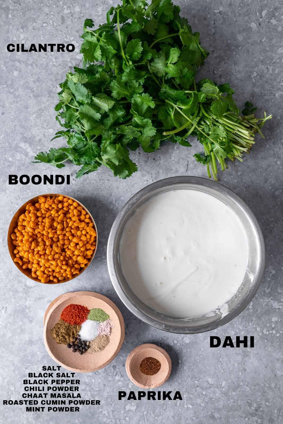flatlay of boondi raita ingredients with labels