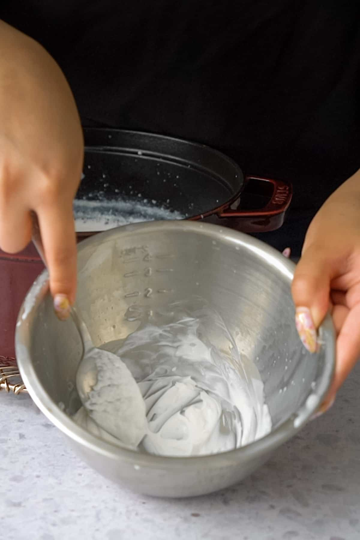 mixing the yogurt starter with a spoon in a bowl