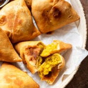 a close up of the paneer aloo samosas ripped open