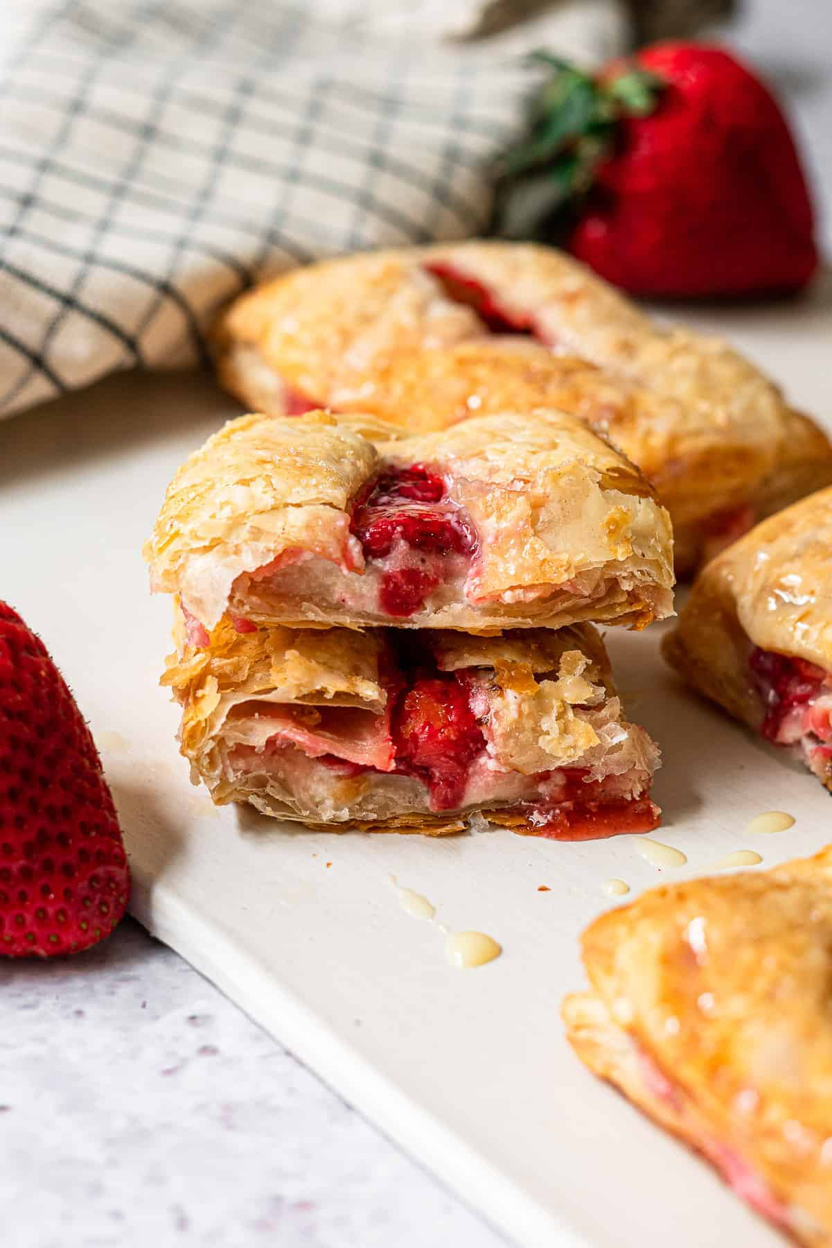 strawberry turnover cut in half and stacked to reveal the cross section