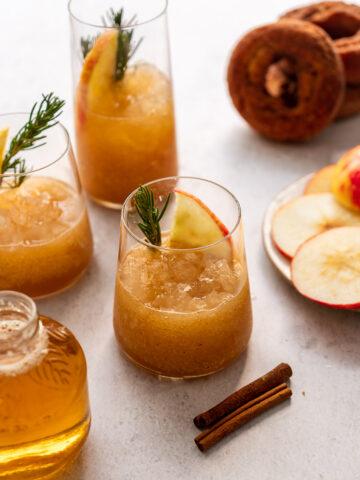 apple cider slushies with apple juice, apple slices, and apple cider donuts