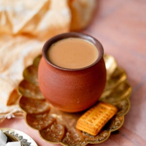 masala chai in a platter with parle g cookies