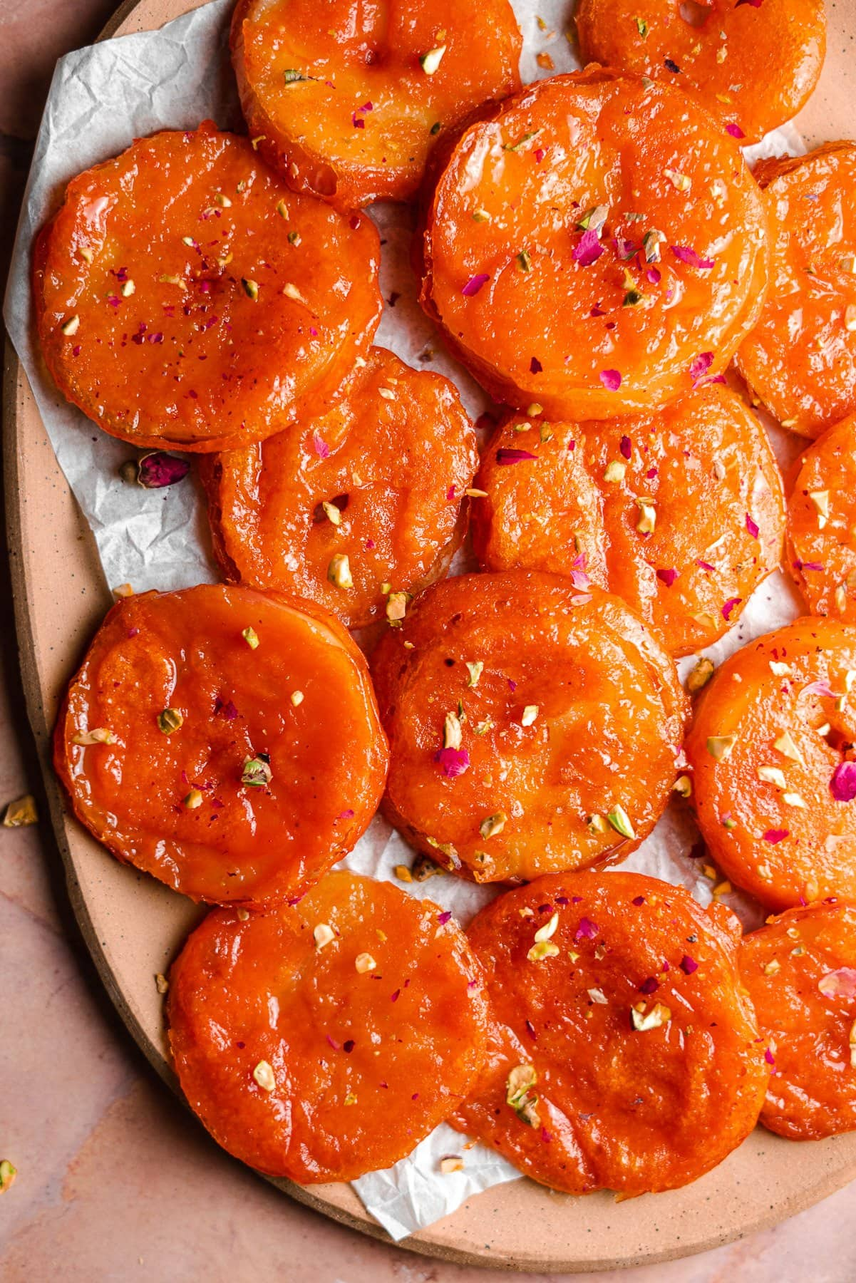 half a platter of apple jalebis with rose ptelas and psitachios