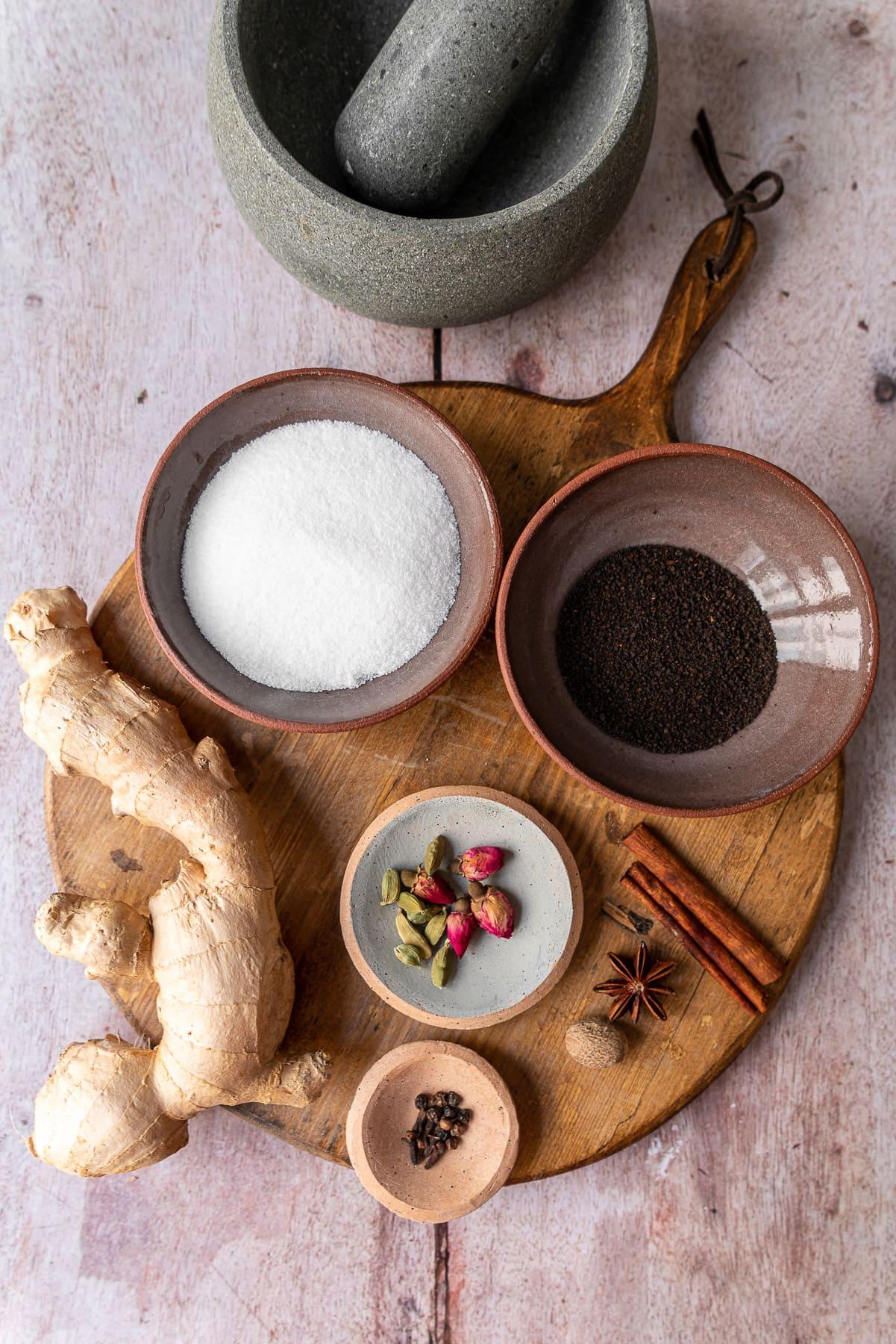 chai ingredients on a wooden bread board