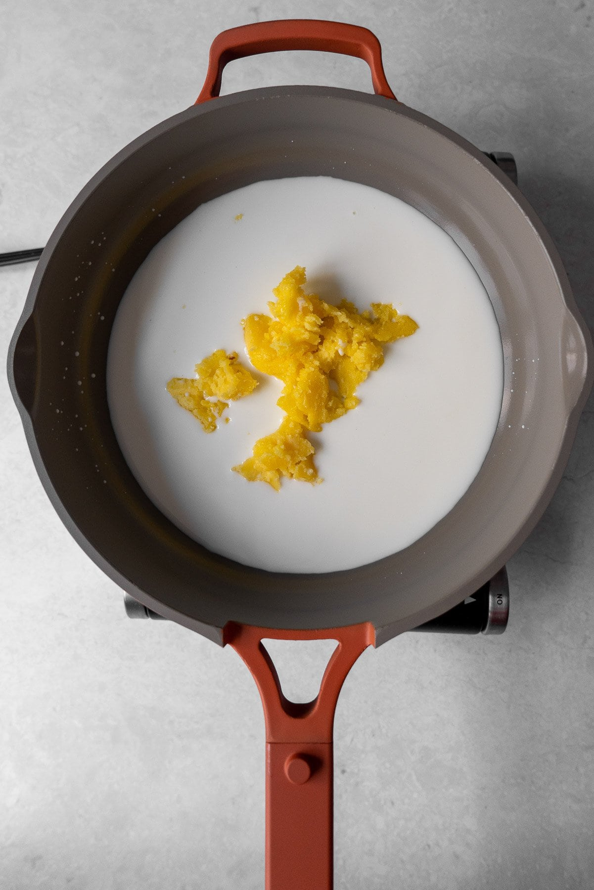 milk with unmelted ghee in pan