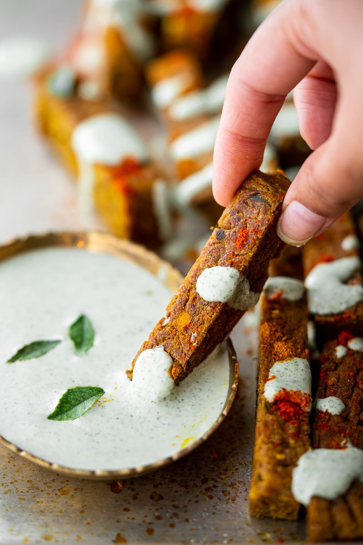 dipping chickpea fry in curry leaf ranch