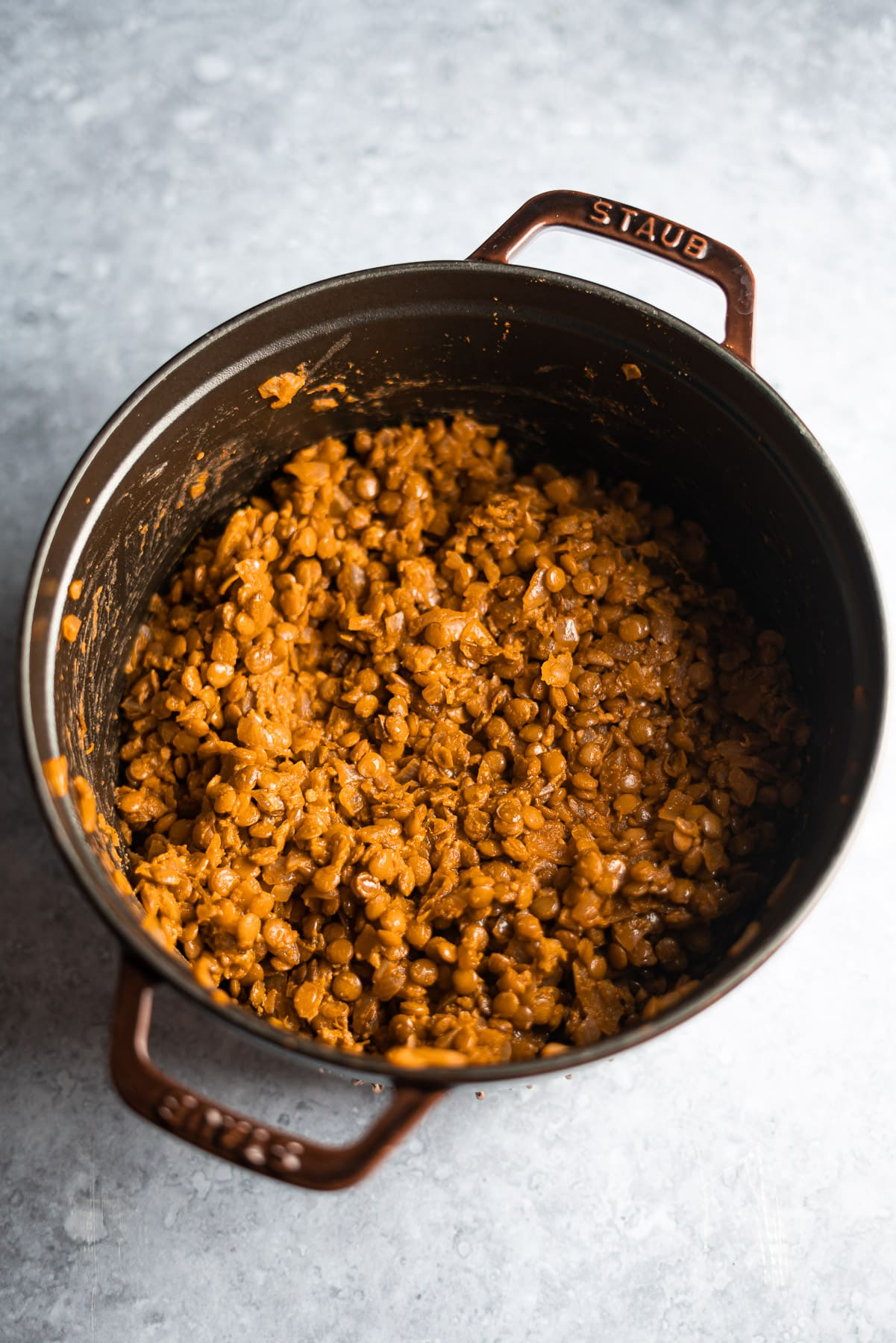 cooked brown lentils in a staub cocotte