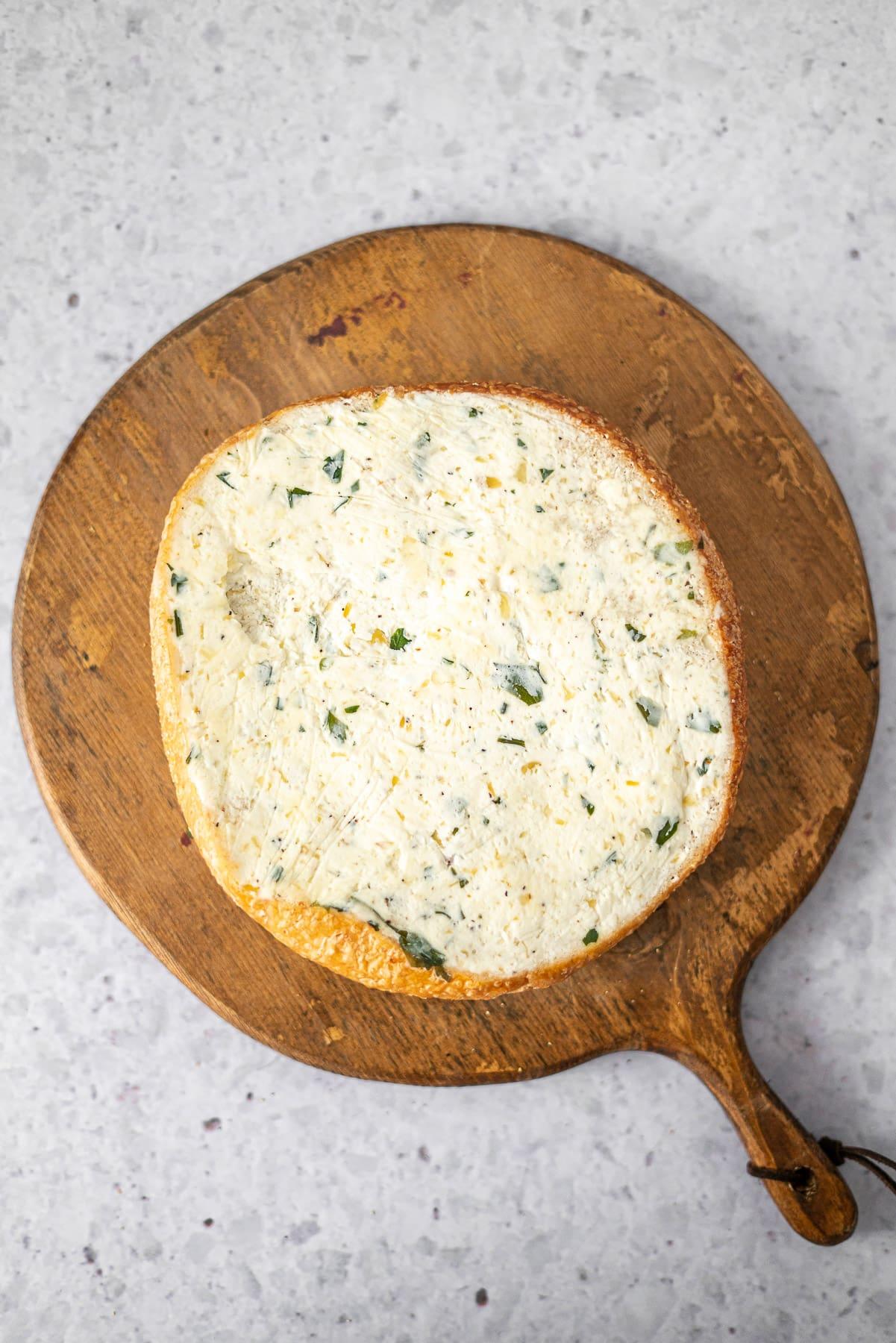 loaf of garlic bread on a wooden board