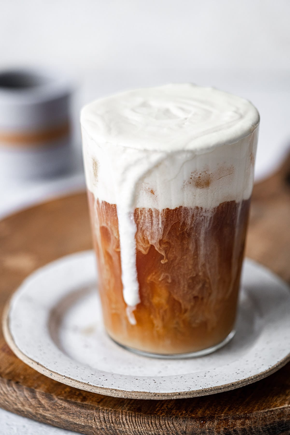 vanilla sweet cream cold foam dripping down the side of an iced coffee